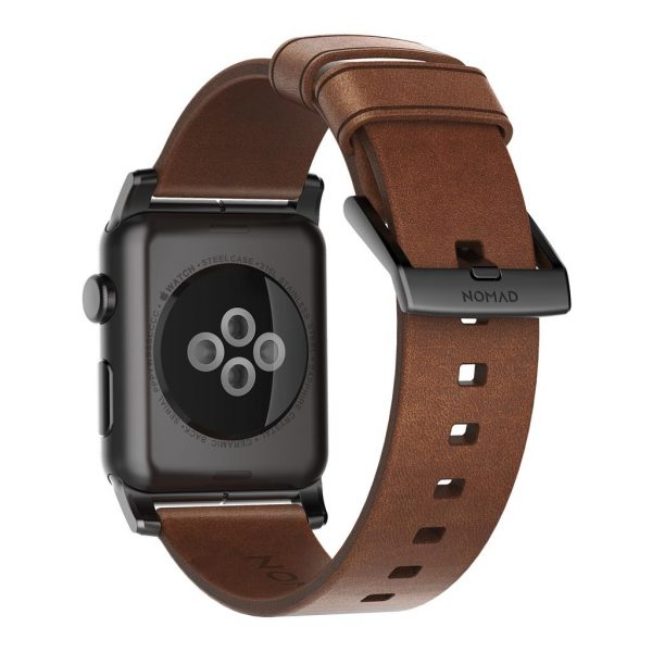 Nomad Apple Watch strap – Modern - Brown - Black Designed to give your Apple Watch a classic, yet bold new look. Made from minimally treated, vegetable tanned leather from one of America's oldest tanneries. The leather is designed to beautifully patina with time, creating a handsome, rich leather strap with a look that is uniquely yours.       Horween leather from the USA  Develops a rugged patina  Custom stainless steel lugs and buckle  Designed for Apple Watch Series 5  Works with all previous versions of Apple Watch, including Apple Watch Series 3