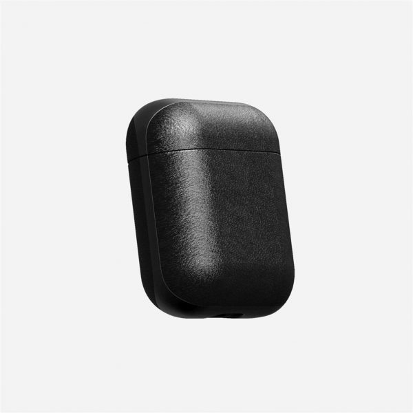 Nomad AirPods Case - Black Leather Designed to give your AirPods a classic, yet bold new look. This minimalist, two-piece Rugged Case is built with genuine, vegetable-tanned leather from one of America's oldest tanneries. The leather is designed to beautifully patina with time, creating an AirPods case truly unique to you.       Designed for AirPods  Horween leather from the USA  Develops a rugged patina  Two-piece construction  Works with AirPods and AirPods with Wireless Charging Case  Note: LED indicator is covered on AirPods with Wireless Charging Case