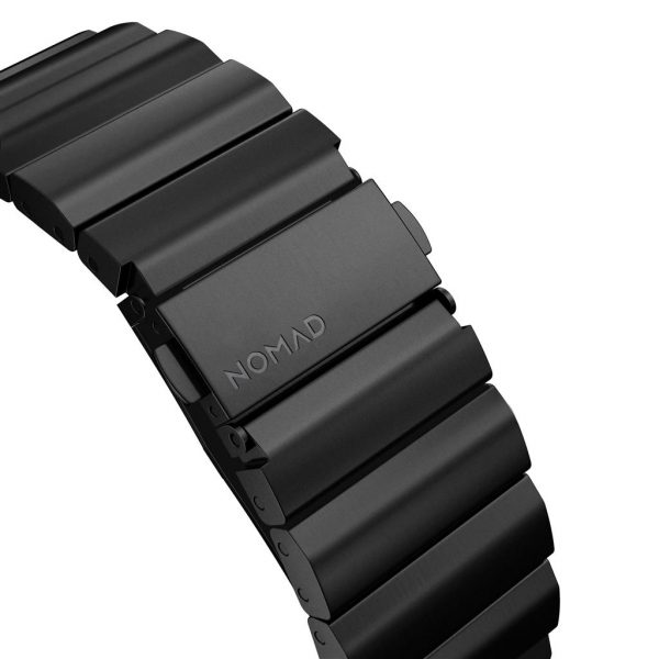 Nomad Apple Watch strap – Titanium – Black – Black Designed for Apple Watch, Titanium Band has been engineered to be as light as possible while giving you the confidence of a high-end metal link bracelet. Leveraging the qualities of high-grade titanium, this is our strongest strap to date. Built with our custom lugs, this lightweight and robust strap can withstand the roughest of conditions.