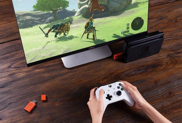 8BitDo USB Wireless Adapter The 8BitDo Wireless Adapter basicly connects everything with everything.  Play your 8BitDo Controllers, Switch Pro, Switch Joy-cons, Xbox One S/X Bluetooth controller, PS4, PS3, Wii Mote, Wii U Pro and more, wirelessly, on Windows PCs, Macs, Raspberry Pi, laptops and even Nintendo Switch.