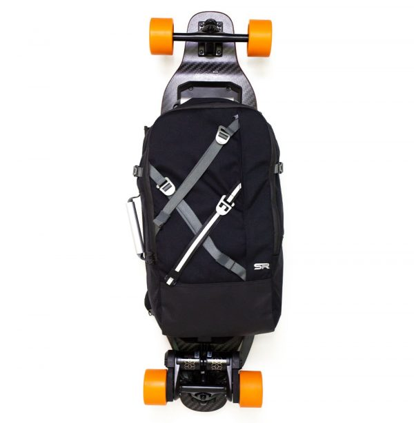 Slick Revolution Electric Skateboard Bag The Slick Revolution (electric) skateboard bag is one of the more premium bags available. It's a camera bag, a laptop bag, a weekend bag and an electric skateboard bag all in one. Perfect for anybody looking to take their skateboard with them, without losing the comfort or features from a regular backpack.  The backpack fits 'most' electric skateboards. What do we mean by 'most'? We mean every eboard which has a flat deck, free of top-mounted batteries or foot straps. For example Boosted, Exway, Evolve and other street brands.